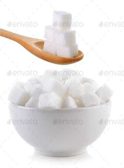sugar cube in the bowl and wood spoon on white background