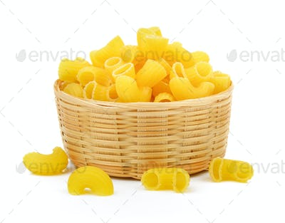 dry macaroni in the basket on white background