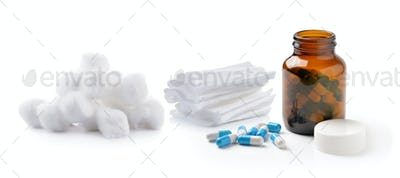 pills out of bottle and Cotton wool bandage on white background