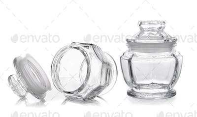Empty glass jar isolated on a white background