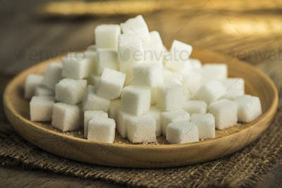 white sugar in a wooden plate