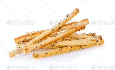 pile of delicious pretzel sticks isolated on white background