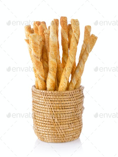 pile of delicious pretzel sticks in basket isolated on white bac