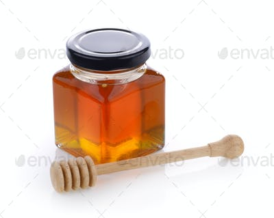 Honey with wooden honey dipper