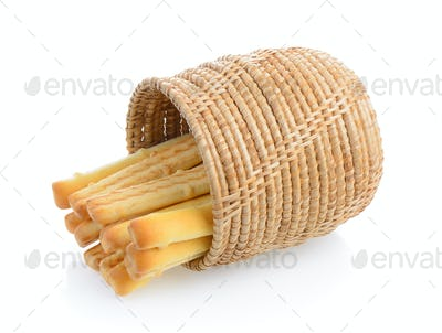 bread sticks in basket isolated on white background