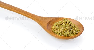 Dried oregano in wood spoon on white background