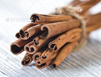 Cinnamon on white wood