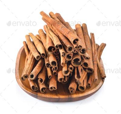 Cinnamon in basket on white background