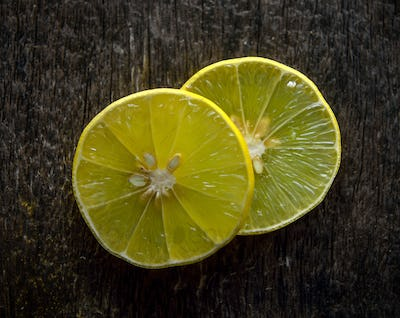 lime slice on wood background