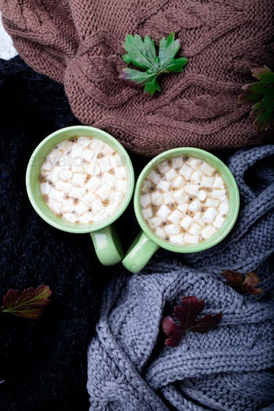 Two cup of coffee near knitted