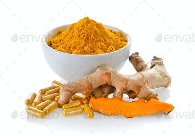 Turmeric powder and turmeric capsules on white background