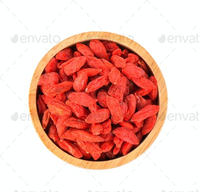 dried goji berries in a small white bowl