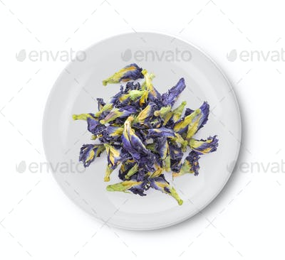 Dried pea flower in plate on white background