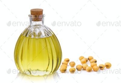 Oil bottle and soybean on white background