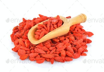 dried goji berries in wood scoop