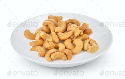 Cashews in white plate isolated on a white background