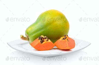 papaya in white plate on white background