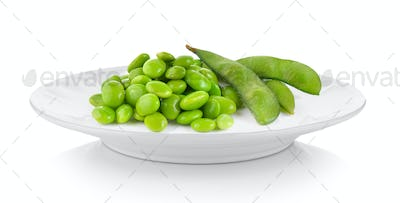 soy beans in plate on white background