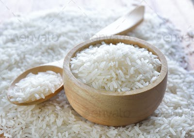 rice in wood bowl and spoon