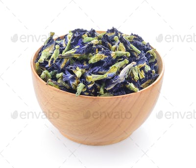 Dried pea flower in wood bowl on white background