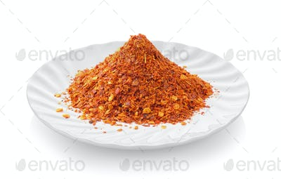 Cayenne pepper in a plate on white background