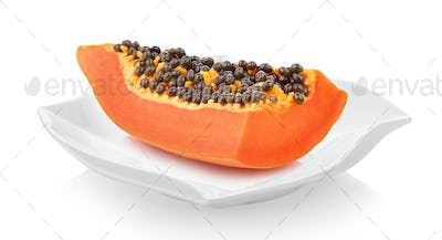 papaya slice in a plate on white background
