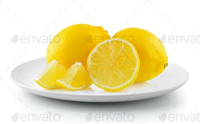 lemon in a plate isolated on a white background