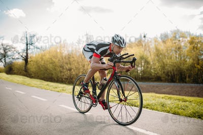 Male cyclist rides on bicycle, front view