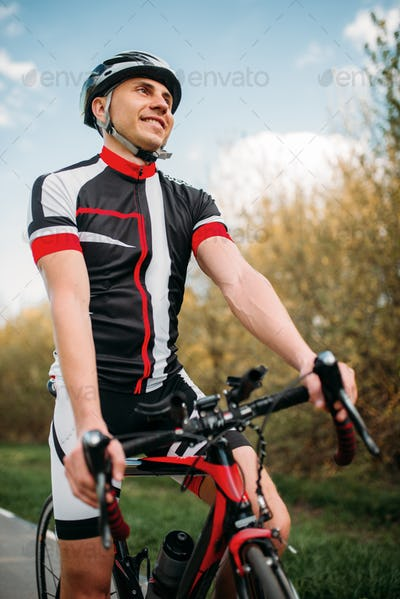 Cyclist in helmet and sportswear on sport bicycle