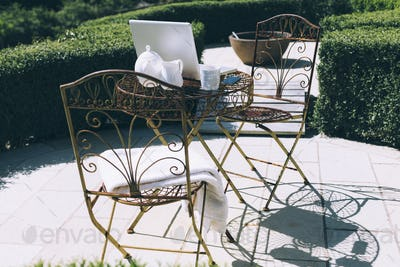 Outdoor garden office setting with forest and mountain views