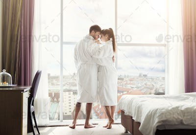 Young couple in love in hotel room in the morning