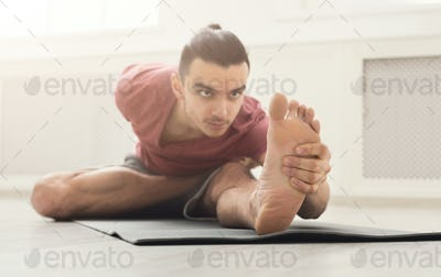 Fitness man at legs stretching training