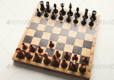 Chessboard with figures in progress