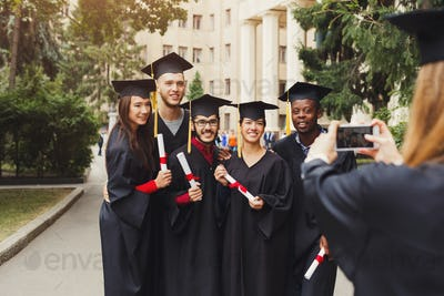 Group of students taking photo on graduation day