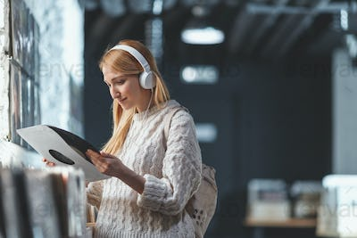 Attractive woman with headphones in a store