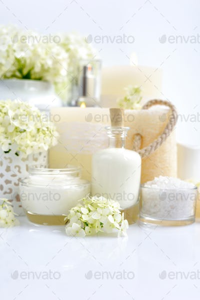 Spa composition with candles, cream, salt and flowers of hydrang
