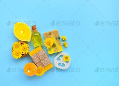 Spa composition with natural soap, candles, aroma oil in bottles