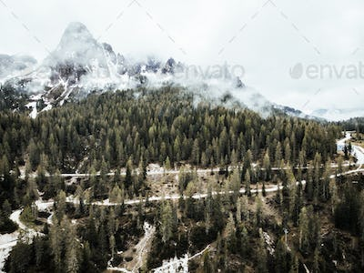 Aerial drone view at Italian Alps in moody weather
