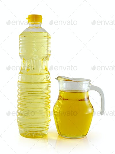 vegetable oil in a plastic bottle and jar on white background