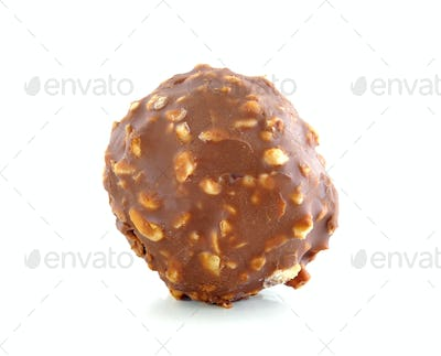 Chocolate ball with almond on white background.