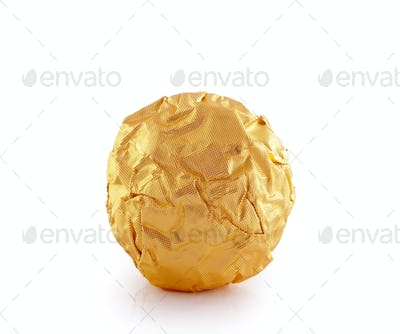 Sweet chocolate candy wrapped in golden foil isolated on white b