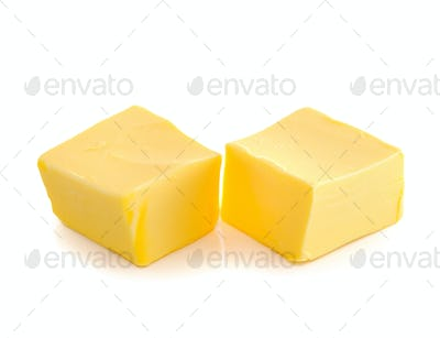 Stick of butter  isolated on white background