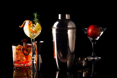 Different cocktails in glass glasses with Bar accessories