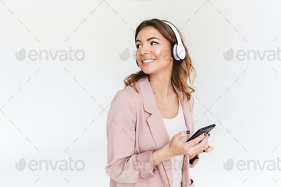 Young cute beautiful woman listening music