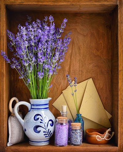 Natural cosmetics with flowers of lavender on wooden background
