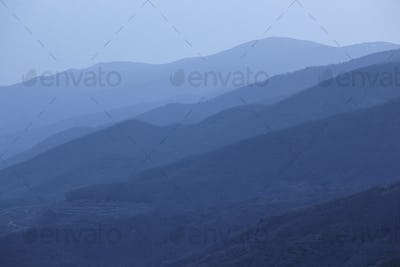 Mountains silhouette at dusk. Jerte valley in blue tone. Spain