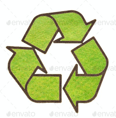 recycle sign from grass