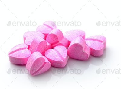 Heart of pills isolated on white background