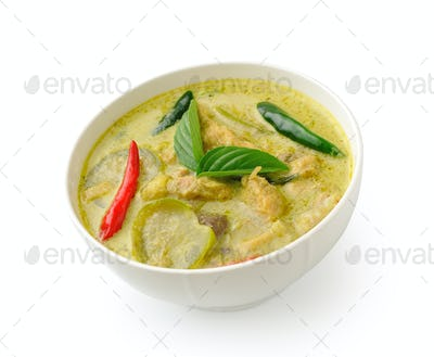 Thai food chicken green curry in the white bolw on white backgro