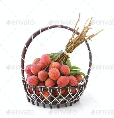 Fresh lychee fruit in basket isolated on white background